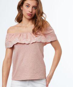 Top hombros al descubierto rosa pálido.