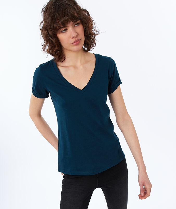 Camiseta escote en v de algodón turquesa.