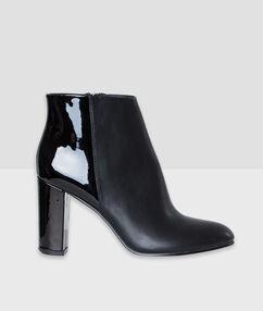 Boots à talons bi-matière noir.