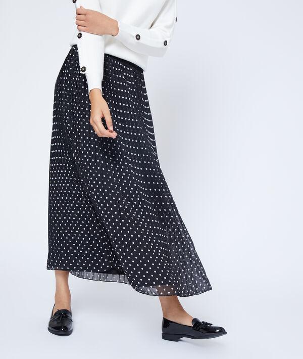 Falda plisada de lunares