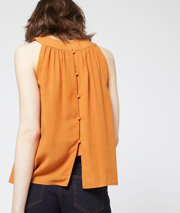 Camiseta  abotonada por la espalda
