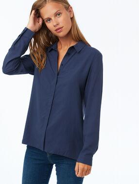 Camisa manga larga azul marino.