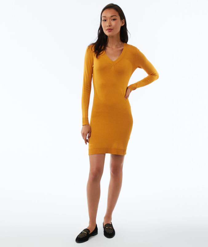 Vestido tipo jersey manga larga escote en v amarillo.
