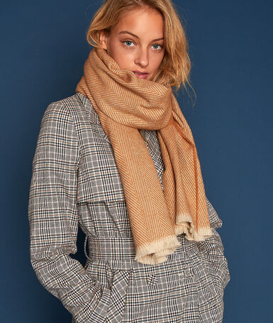 Plaid en jacquard roux.