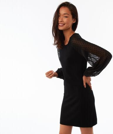 Robe manches transparentes à plumetis noir.