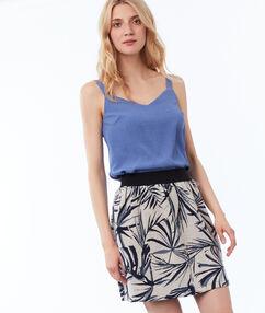Falda estampado hojas azul marino.