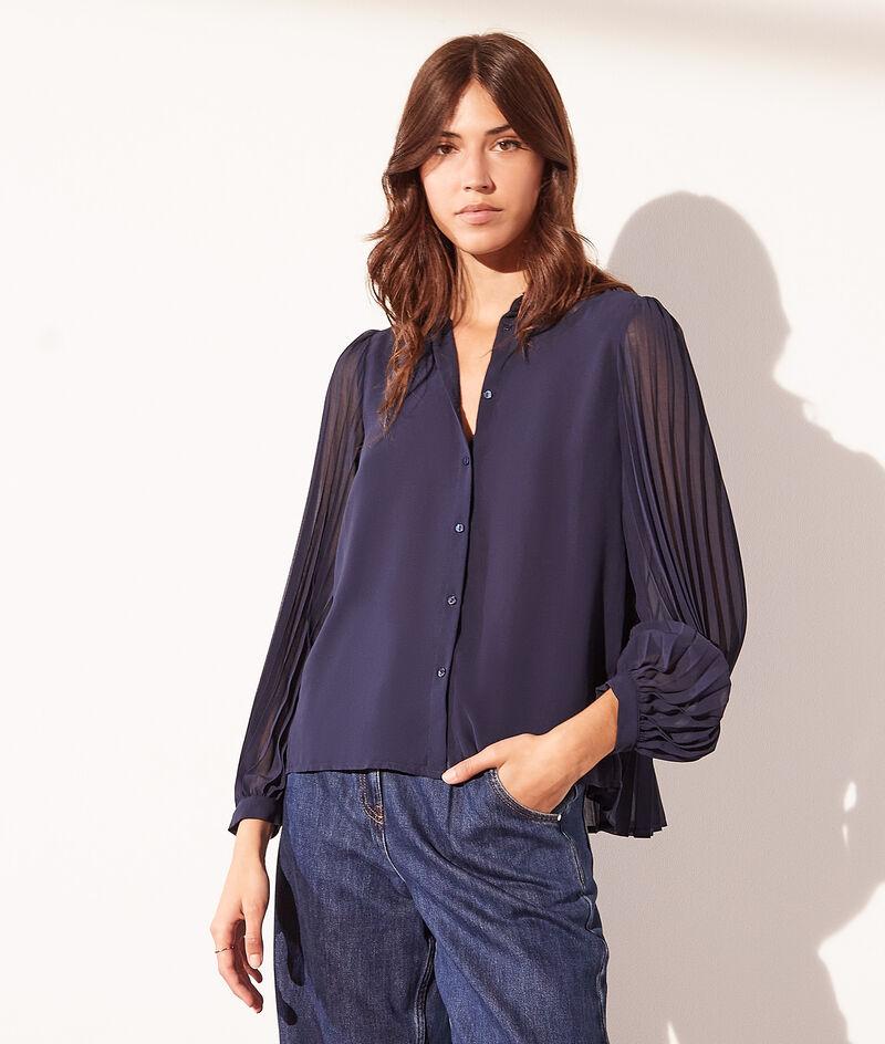 Blusa con detalles plisados