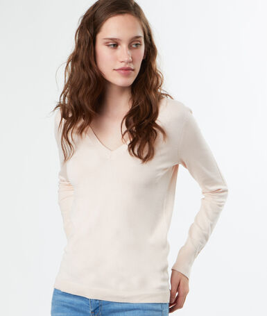 Jersey fino escote en v rosa pálido.