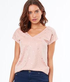 T-shirt imprimé rose pâle.