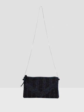 Bolso adornos brillantes negro.