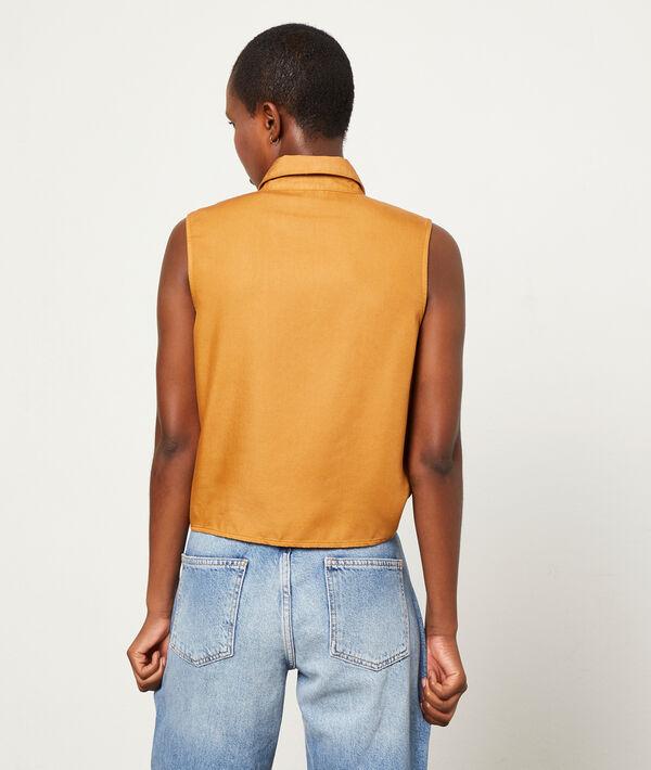 Camisa sin mangas con lazada