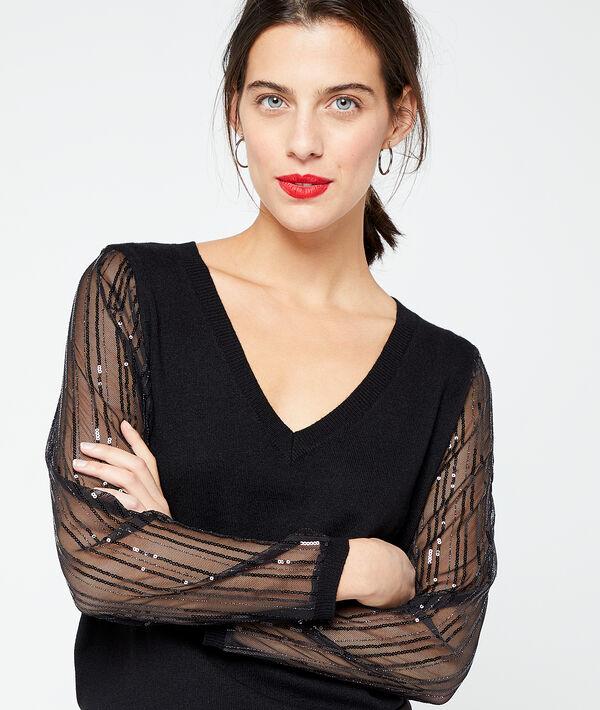 Suéter con lentejuelas y manga transparente