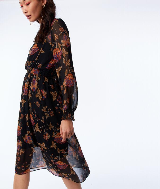 Vestido semitransparente estampado floral negro.
