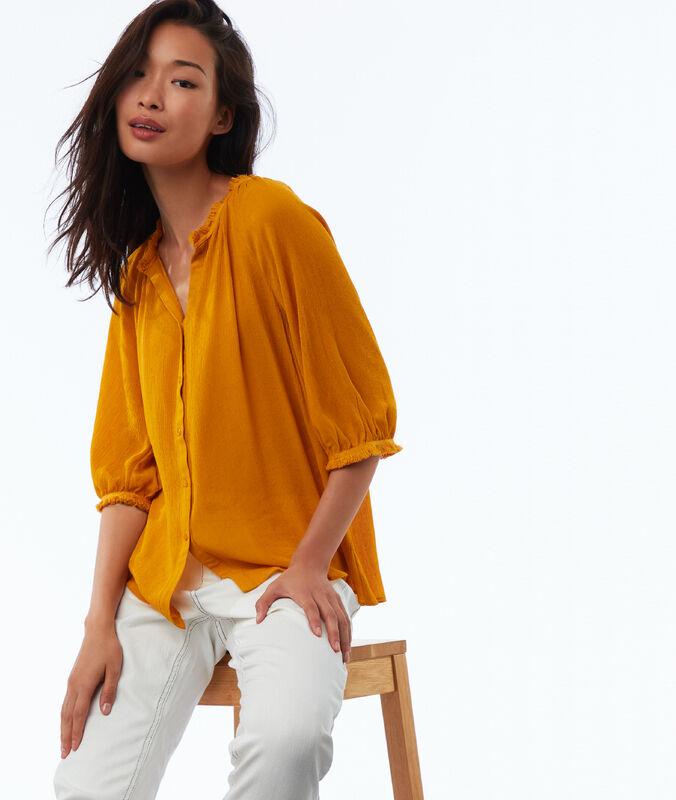 Blusa mangas abullonadas amarillo.