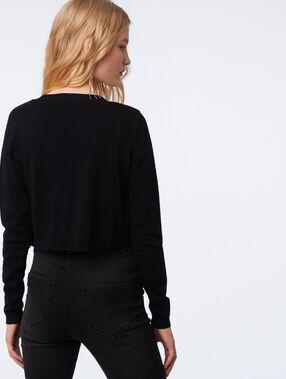 Jersey corto negro.