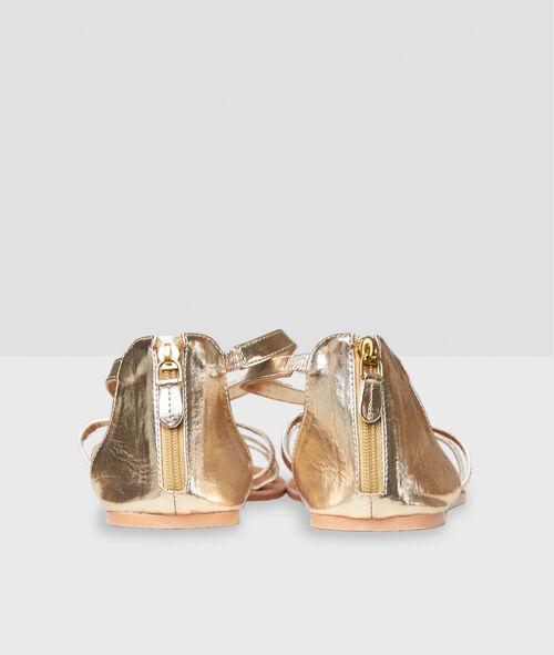Sandalias planas con ornamentos