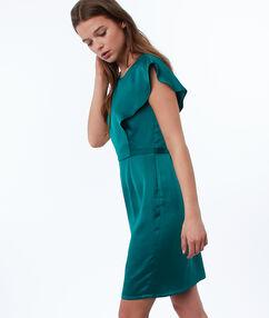Vestido liso ajustado verde esmeralda.