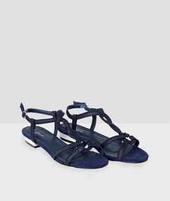 Sandalias planas purpurina azul.
