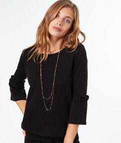 Sweat-shirt en coton noir.