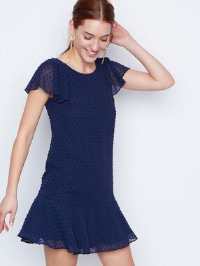 Vestido holgado tejido plumetis azul marino.
