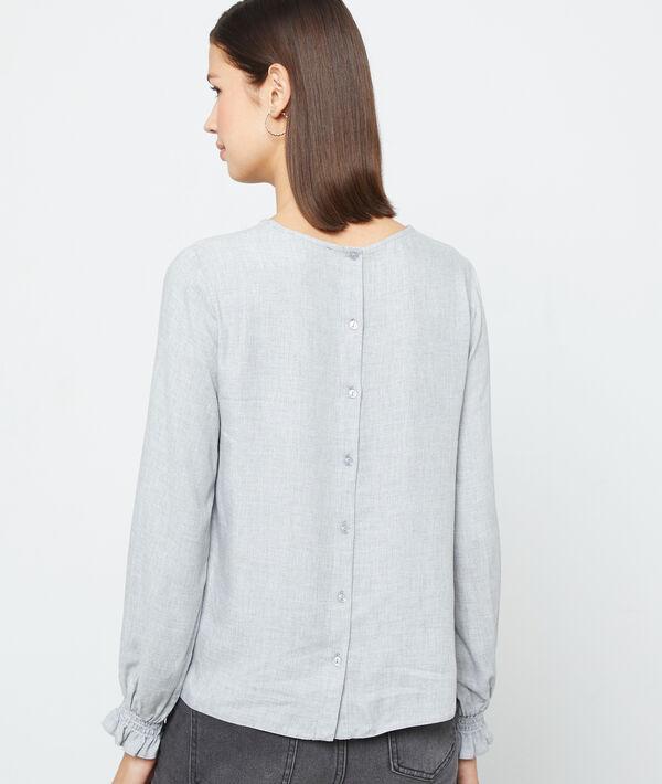 Blusa con la espalda abotonada