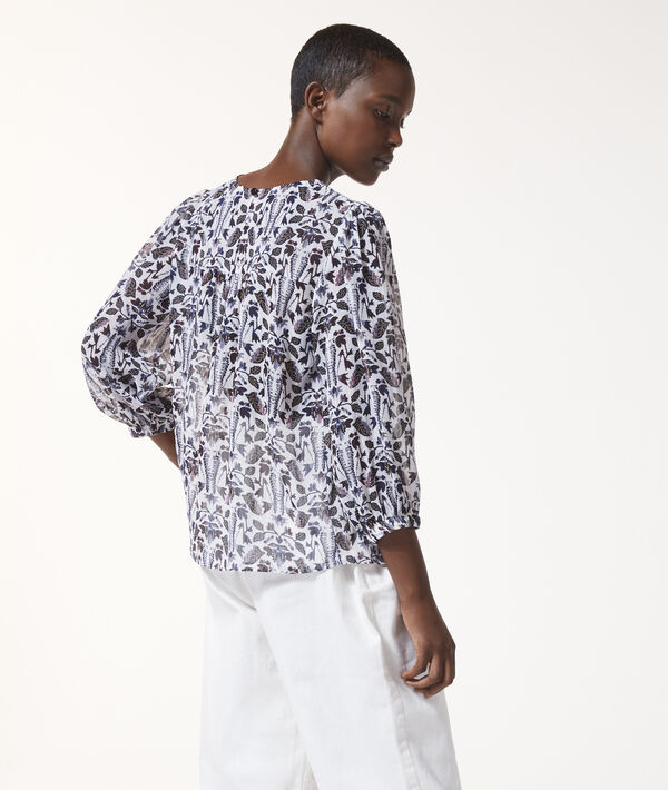 Blusa de cuello redondo con estampado floral