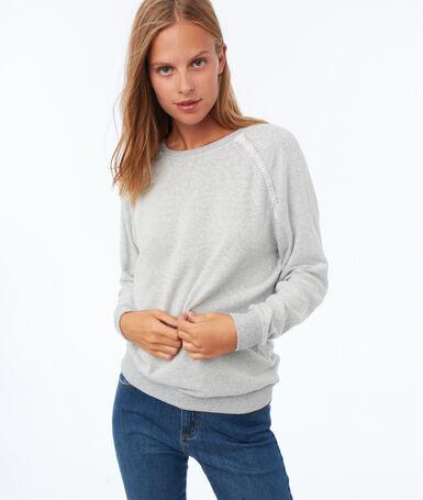 Sweat shirt détail guipure gris chiné clair.
