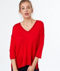 Jersey cuello en v rojo.